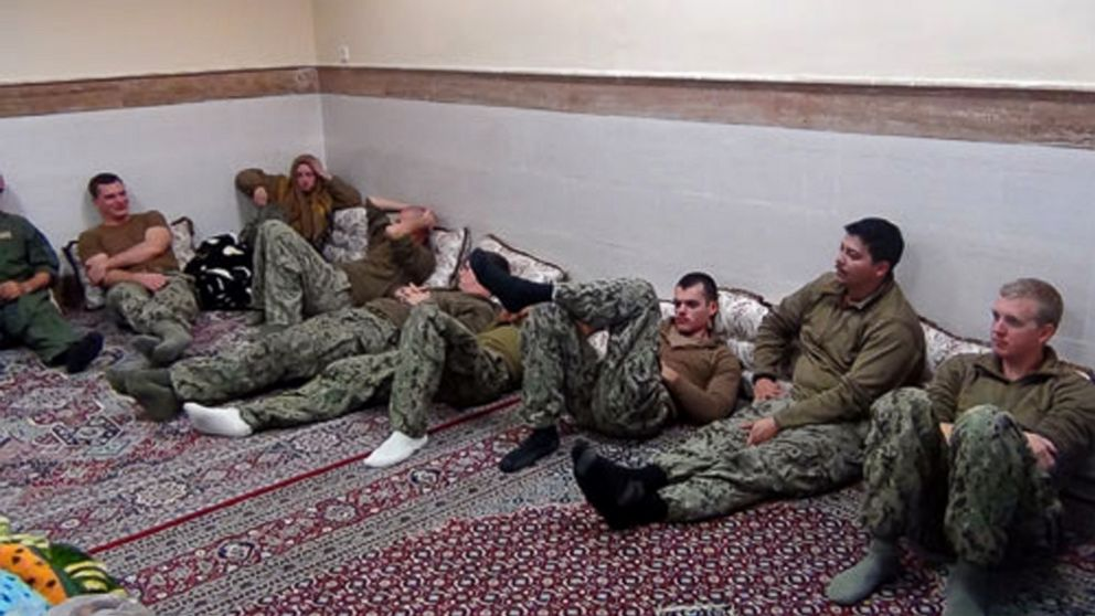 This picture released by the Iranian Revolutionary Guards, Jan. 13, 2016, shows detained American Navy sailors in an undisclosed location in Iran.
