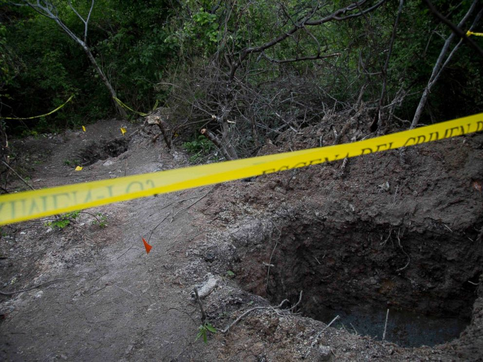 PHOTO: In this Oct. 6, 2014 file photo, clandestine graves are taped off after 28 bodies were found in them near Iguala, Mexico.