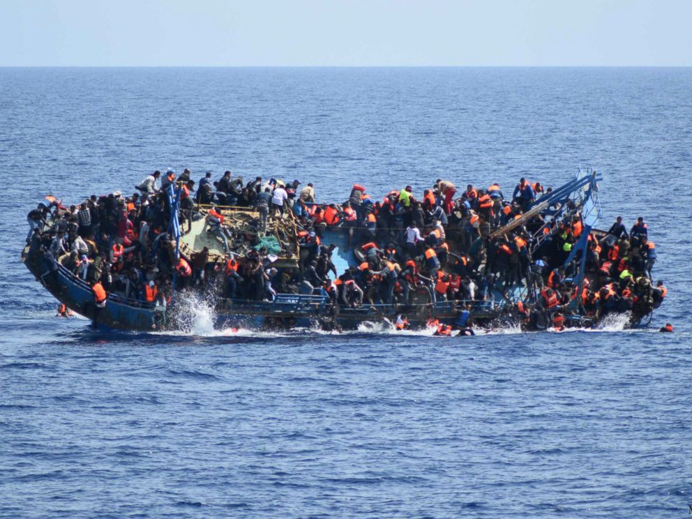 PHOTO:People jump out of a boat right before it overturns off the Libyan coast, May 25, 2016.
