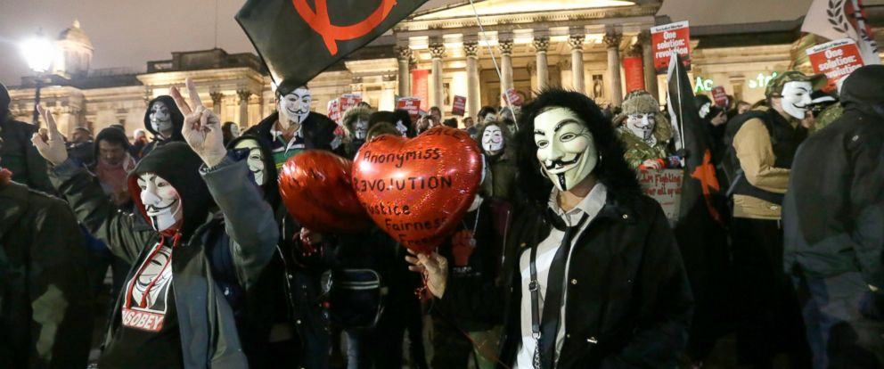 PHOTO: Masked demonstrators gather in Trafalgar Square in central London during the Million Mask protest march, Nov. 5, 2015.
