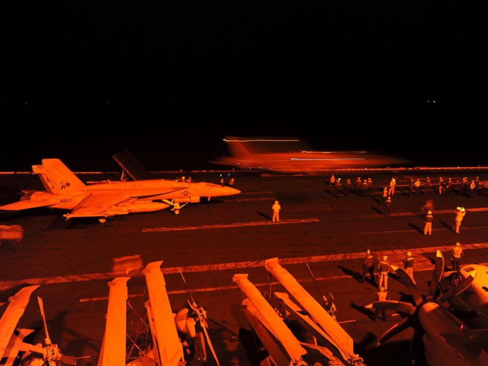 PHOTO: A-18E Super Hornet, prepares to launch from the flight deck of the aircraft carrier USS George H.W. Bush to conduct strike missions against Islamic State group targets, in the Arabian Gulf, Sept. 23, 2014.
