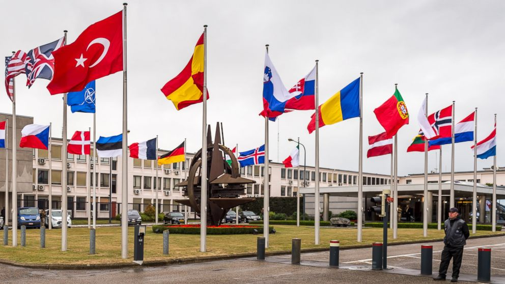 NATO country flags wave outside NATO headquarters in Brussels, July 28, 2015.