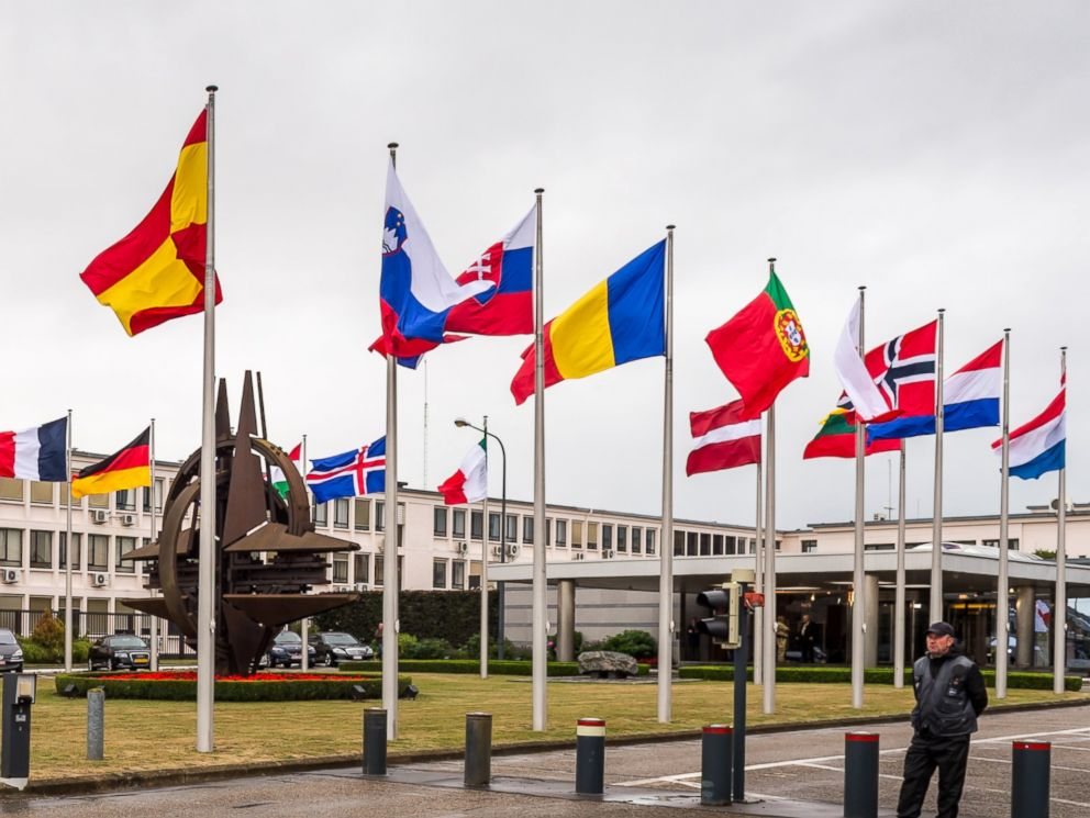 PHOTO: NATO country flags wave outside NATO headquarters in Brussels, July 28, 2015.