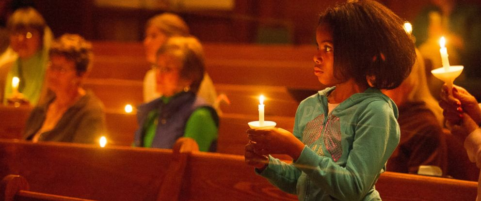 PHOTO: A young child joins others in a candlelight vigil for the more than 300 girls abducted by Boko Haram in Nigeria, at All Souls Unitarian Church in Colorado Springs, Colo., May 8, 2014.