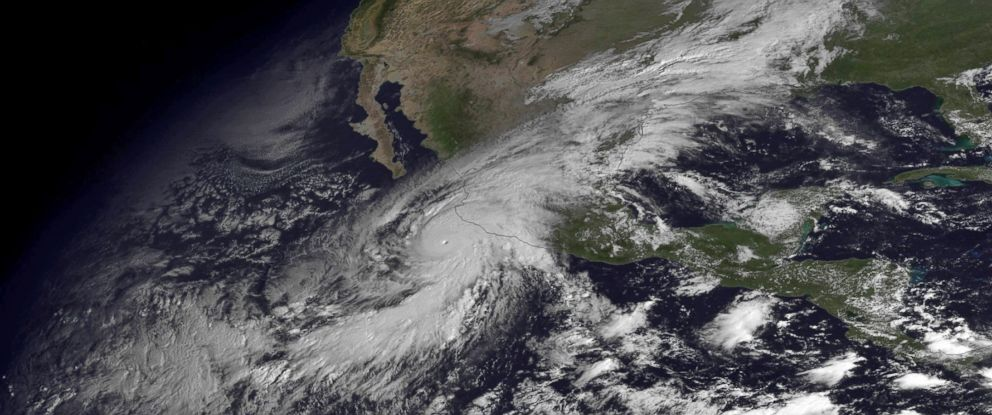 PHOTO: This satellite image taken at 10:45 a.m. EDT on Friday, Oct. 23, 2015, and released by the National Oceanic and Atmospheric Administration shows Hurricane Patricia moving over Mexicos Pacific Coast.
