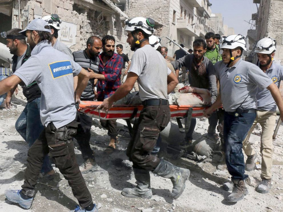 PHOTO: Syrian Civil Defense White Helmets, rescue workers work the site of airstrikes in the al-Sakhour neighborhood of the rebel-held part of eastern Aleppo, Syria.
