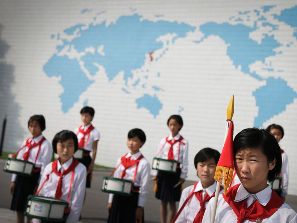 PHOTO: North Korean school girls stand in formation during an opening ceremony for the start of summer activities at the Songdowon International Childrens Camp, July 29, 2014, in Wonsan, North Korea.