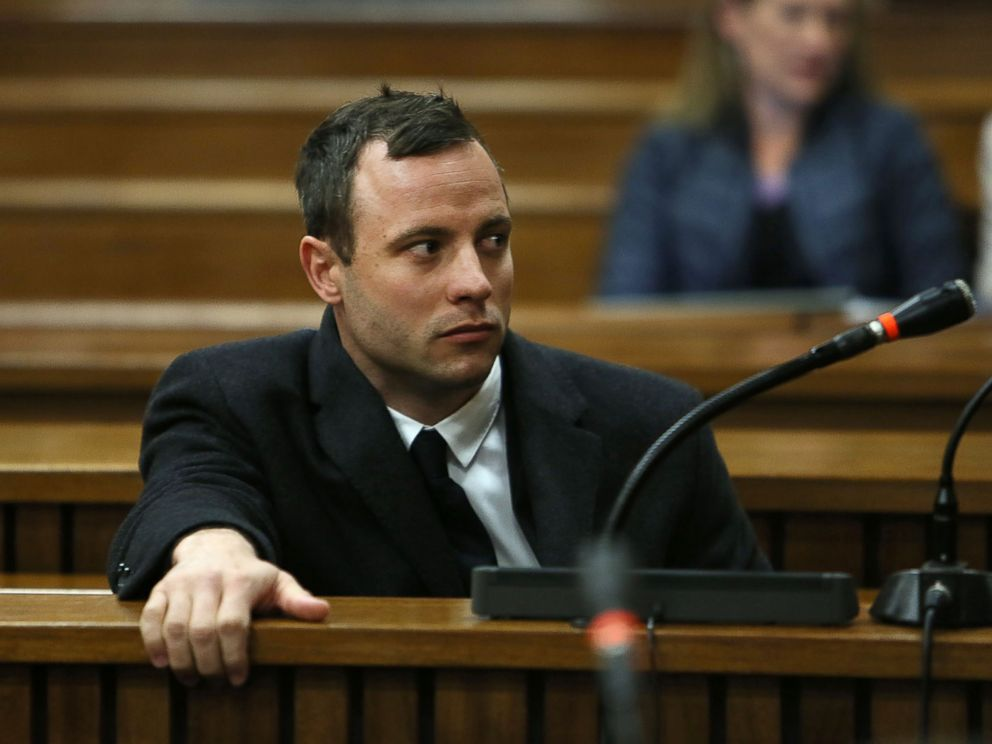 PHOTO: Oscar Pistorius attends court at his murder trial for the shooting death of his girlfriend Reeva Steenkamp on St. Valentines Day 2013 in Pretoria, South Africa, July 8, 2014.