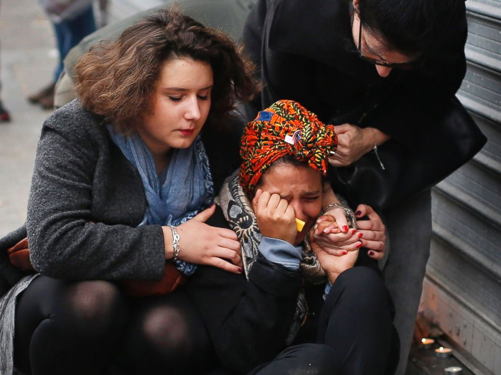 PHOTO: A woman is comforted by others outside the Carillon cafe and the Petit Cambodge restaurant in Paris, Nov. 14, 2015, a day after over 120 people were killed in a series of attacks in Paris.