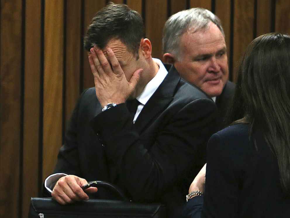 PHOTO: Oscar Pistorius puts his hand to his face at the end of the day in court on the third day of his trial at the high court in Pretoria, South Africa, March 5, 2014.