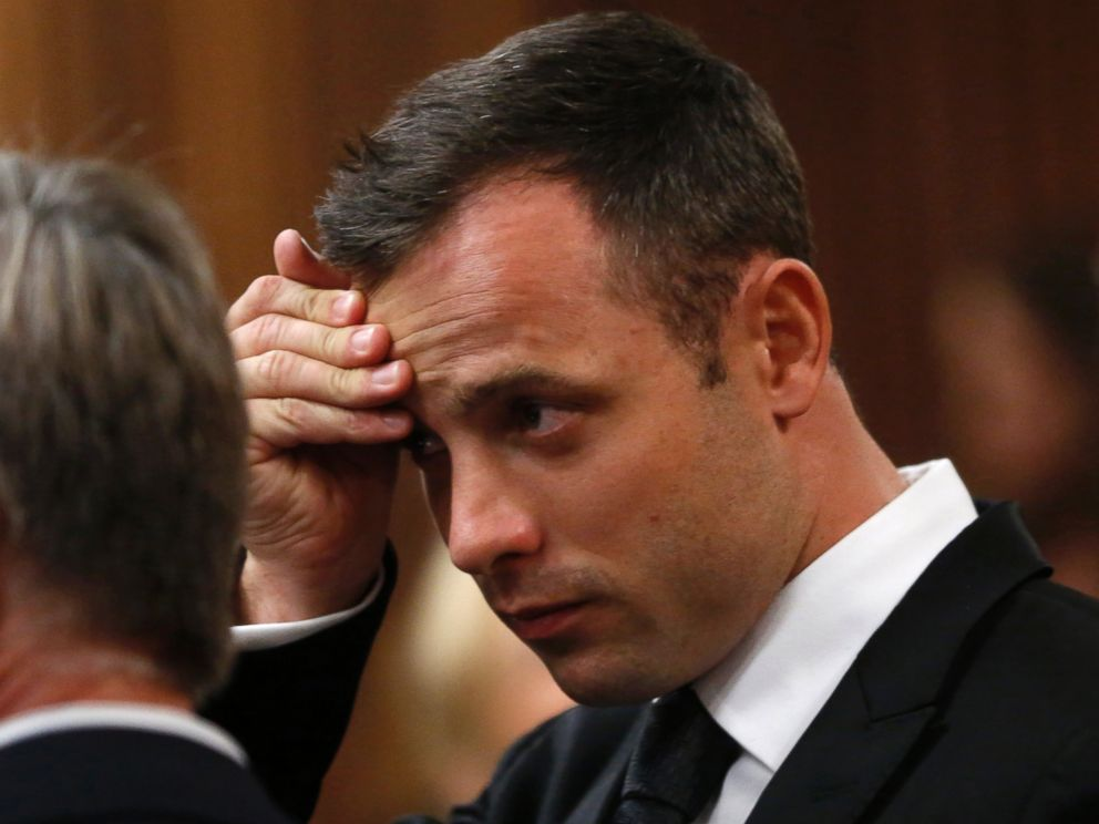 PHOTO: Oscar Pistorius holds his head in court on the third day of his trial at the high court in Pretoria, South Africa, March 5, 2014.