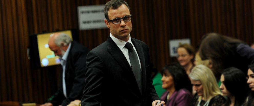 PHOTO: Oscar Pistorius returns to court after a break during his court case in Pretoria