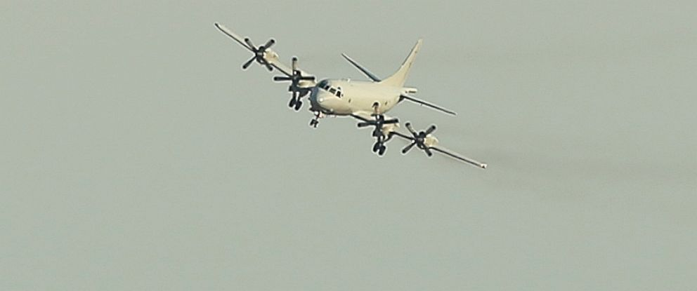 PHOTO: A Royal Australian Air Force P-3 Orion approaches RAAF Base Pearce as it arrives back from the on-going search operations for the missing Malaysia Airlines Flight 370 in Perth, Australia, April 8, 2014.