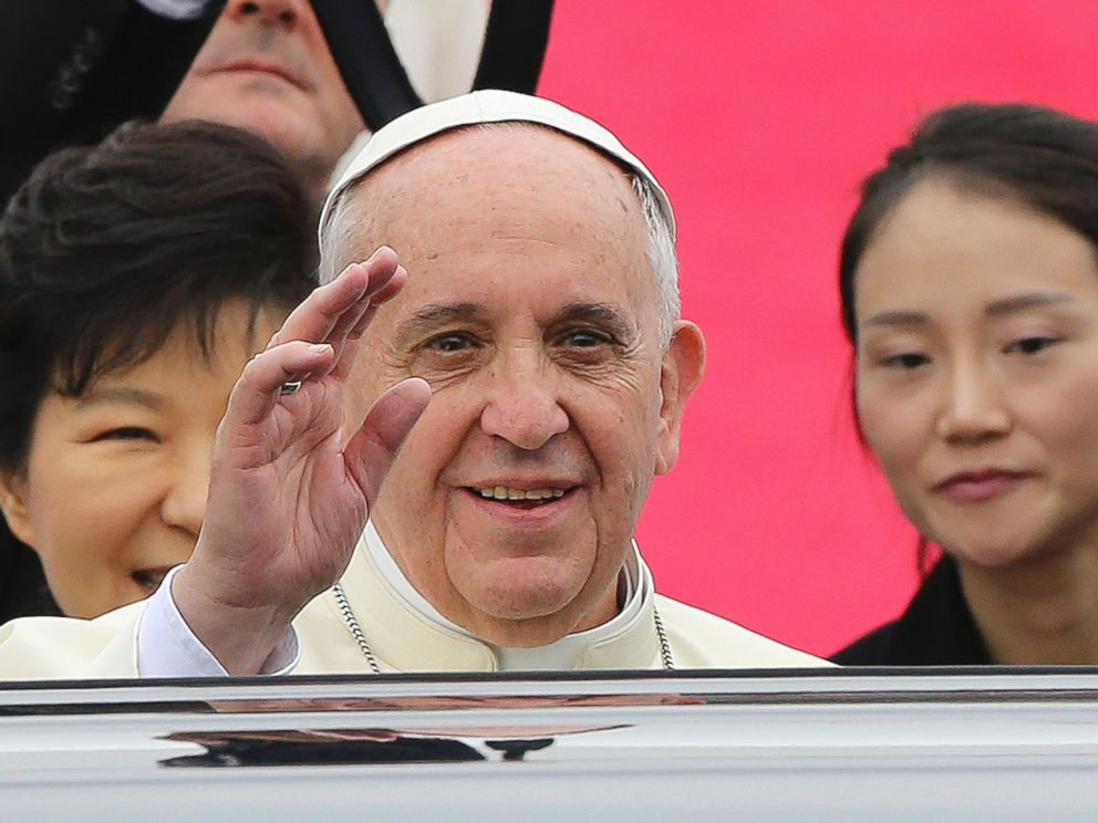 PHOTO: Pope Francis waves upon his arrival at Seoul Air Base as South Korean President Park Geun-hye, left, smiles in Seongnam, South Korea, Aug. 14, 2014.