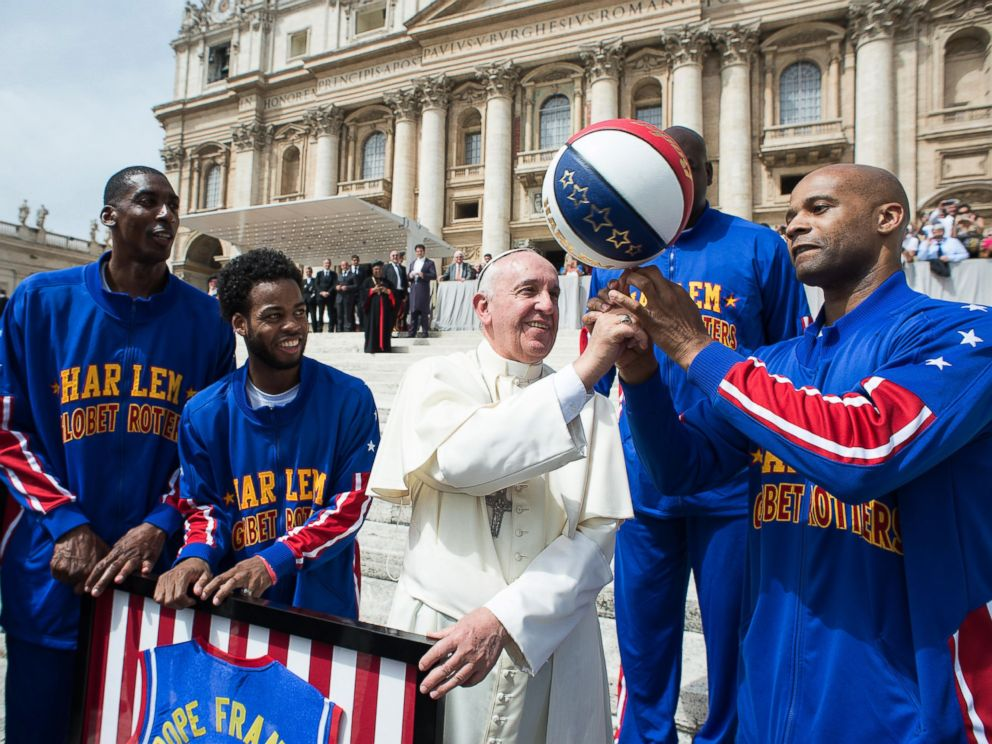 PHOTO: Harlem Globetrotters' help Pope Francis spin the ball on his finger as they meet in St. Peters Square at the Vatican, May 6, 2015.
