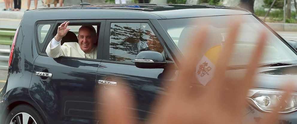 PHOTO: Pope Francis waves from a car after his arrival in Seongnam, South Korea, Aug. 14, 2014.