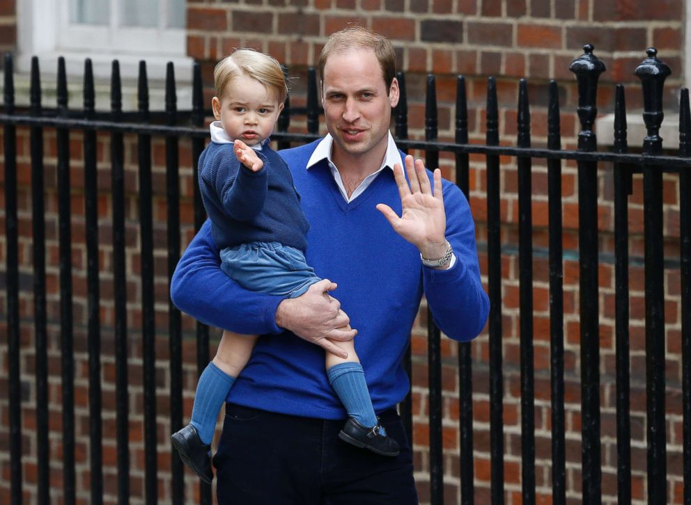 PHOTO: Britains Prince William and his son Prince George wave as they return to St. Marys Hospitals exclusive Lindo Wing, London, May 2, 2015.