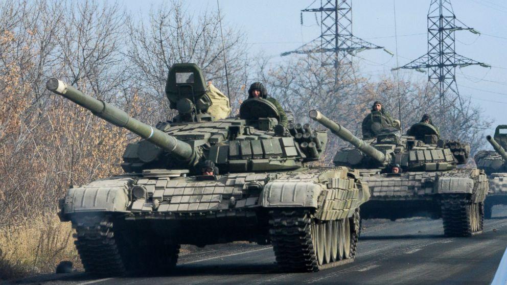 Pro-Russian rebel military vehicles convoy move towards Donetsk , Eastern Ukraine, Nov. 10, 2014.