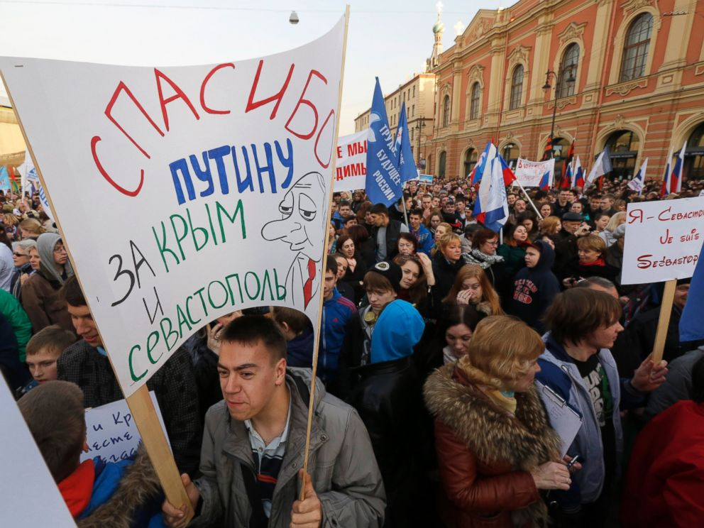 PHOTO: Demonstrators gather for a concert marking the one year anniversary of the annexation of Ukraines Crimea peninsula in St.Petersburg, Russia, March 18, 2015.