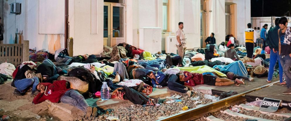 PHOTO: Refugees sleep at the train station as they wait for their transit to Western Europe in Tovarnik, Croatia, Sept. 18 2015.