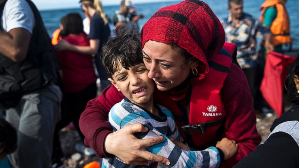 A Syrian woman embraces her child after they arrived with others refugees on a dinghy from Turkey to Lesbos island, Greece, Sept. 11, 2015.