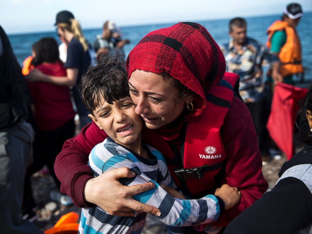 PHOTO:A Syrian woman embraces her child after they arrived with others refugees on a dinghy from Turkey to Lesbos island, Greece, Sept. 11, 2015.