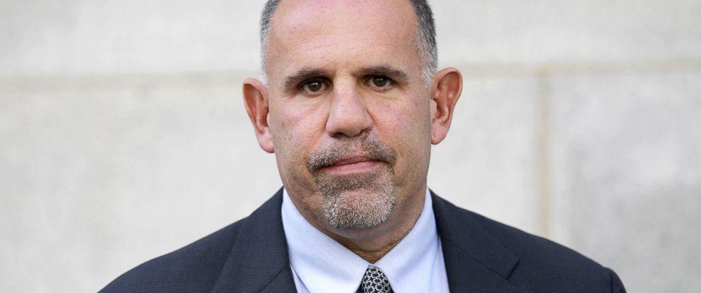 PHOTO: Retired FBI agent Robert G. Lustyik Jr. leaves federal court in Salt Lake City, Oct. 30, 2012.