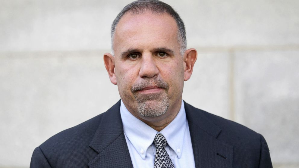 Retired FBI agent Robert G. Lustyik Jr. leaves federal court in Salt Lake City, Oct. 30, 2012.