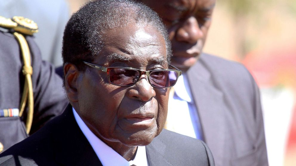 Zimbabwean President, Robert Mugabe, attends the burial of Major General Bandama who died after a short illness at the National Heroes acre in Harare, Zimbabwe, July, 17, 2014.