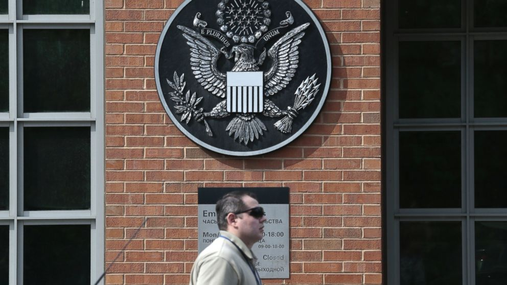 A man passes an entrance of the U.S. Embassy in downtown Moscow, Russia, on Tuesday, May 14, 2013.