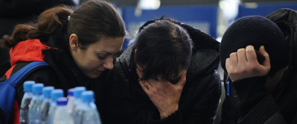 PHOTO: A Russian Emergency Situations Ministry employee, left, tries to comfort a relative of the plane crash victims at the Rostov-on-Don airport on Saturday, March 19, 2016. FlyDubai flight 981 crashed while landing in Rostov-on-Don, officials said.