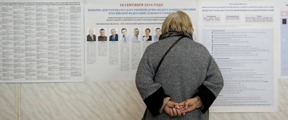 PHOTO: A woman reads pre-election leaflets at a polling station in Smolensk, western Russia, Sept. 18, 2016.