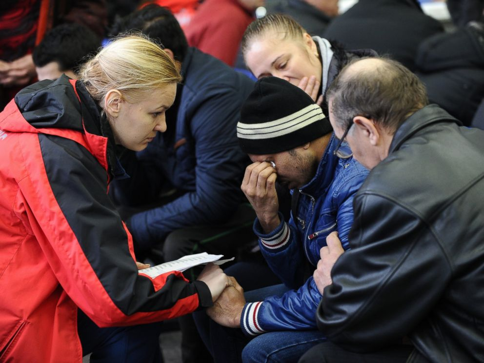 PHOTO: A Russian Emergency Situations Ministry employee, left, tries to comfort a relative of the plane crash victims at the Rostov-on-Don airport, Russia, March 19, 2016.