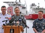 PHOTO: U.S. Navy Captain Mark Matthews right, Royal Australian Navy Commodore Peter Leavy commander of join task force 658, center, and Chief of the Navy Vice Admiral Ray Griggs speak at a press conference about the Defense ship Ocean Shield.