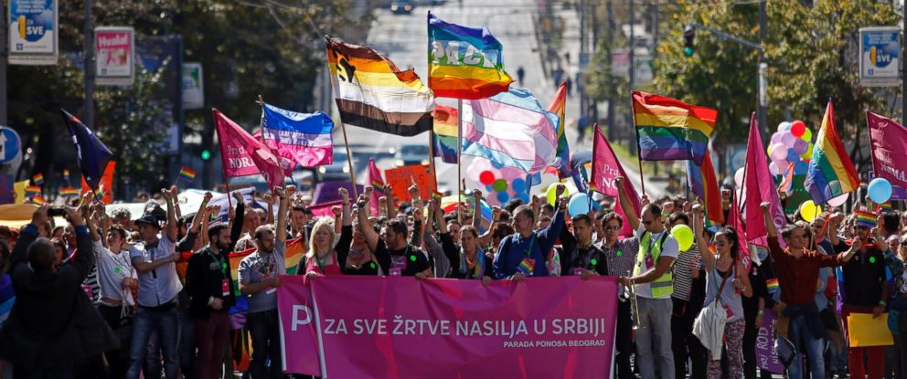PHOTO: Gay activists wave flags during the Pride March in Belgrade, Serbia, Sept. 28, 2014.