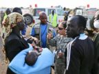 PHOTO: Wounded civilians from Bor, the capital of Jonglei state, are assisted after being transported by U.N. helicopter to Juba, South Sudan, Sunday, Dec. 22, 2013.