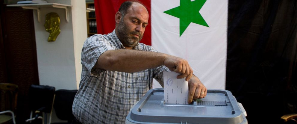 PHOTO: A man casts his ballot in Damascus, Syria, June 3, 2014.