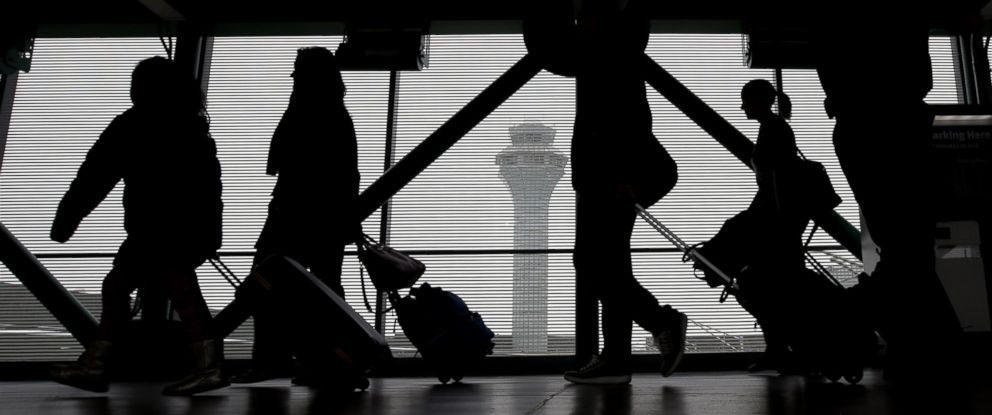 PHOTO: Passengers walk through Terminal 3 at OHare International Airport, Nov. 21, 2015, in Chicago.