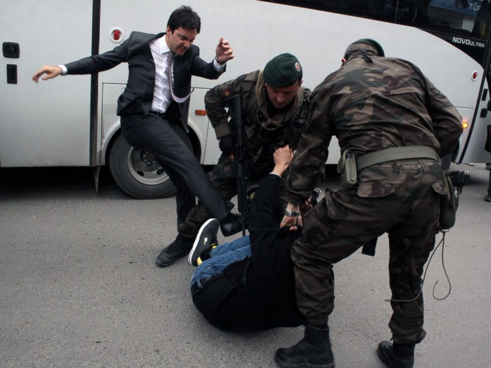 PHOTO: A person identified by Turkish media as Yusuf Yerkel, advisor to Turkish Prime Minister Recep Tayyip Erdogan, kicks a protester already held by special forces police members during Erdogans visiting Soma, Turkey, May 14, 2014.