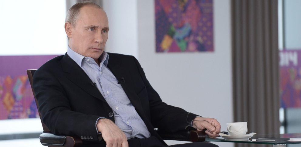 PHOTO: Russian President Vladimir Putin listens to a translation during an interview to Russian and foreign media at the Russian Black Sea resort of Sochi, in this Friday, Jan. 17, 2014.
