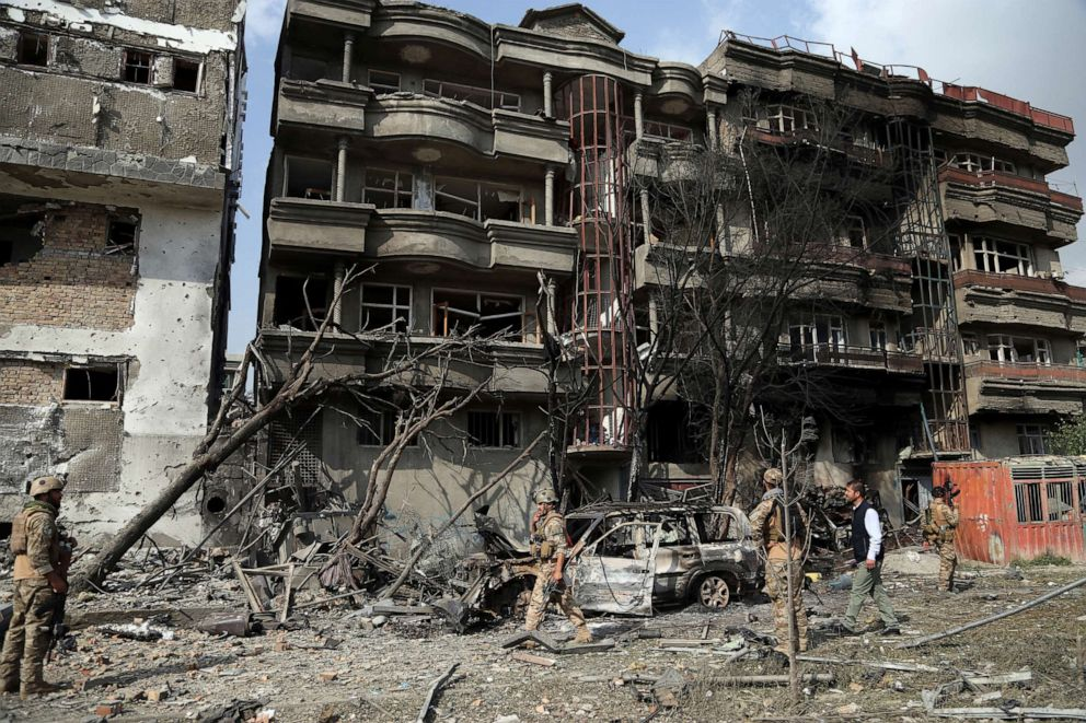 PHOTO: Afghan security forces inspect the aftermath of Sundays attack in Kabul, Afghanistan, Monday, July 29, 2019.