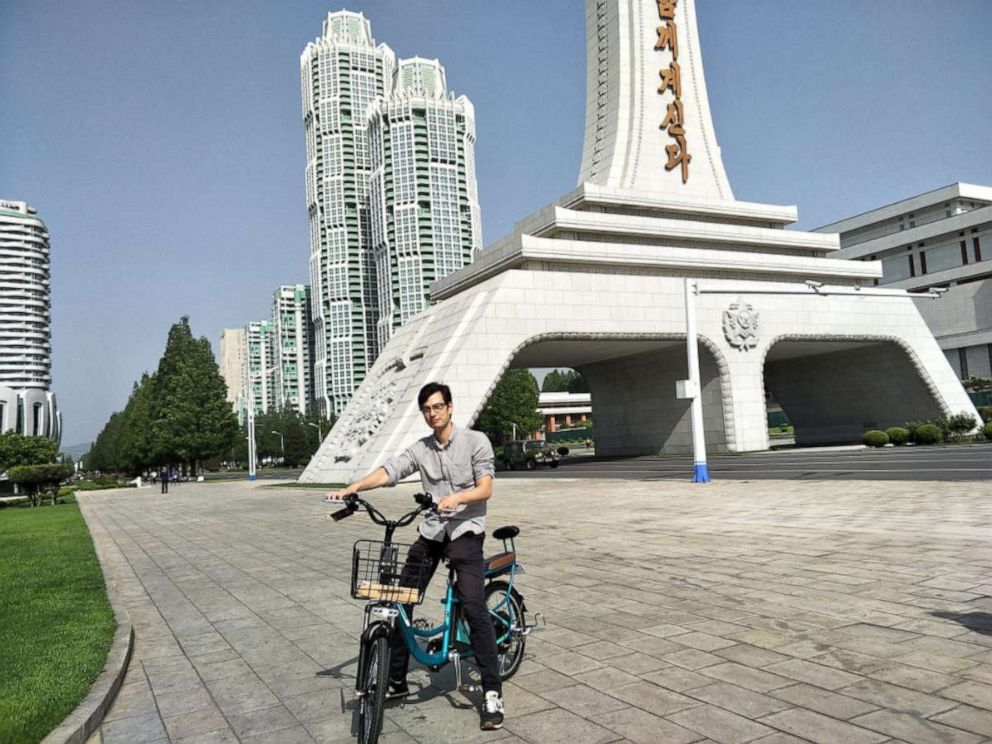 PHOTO: Alek Sigley stops for a photo in front of the Tower of Eternal Life, Pyongyang, North Korea, May 2018.