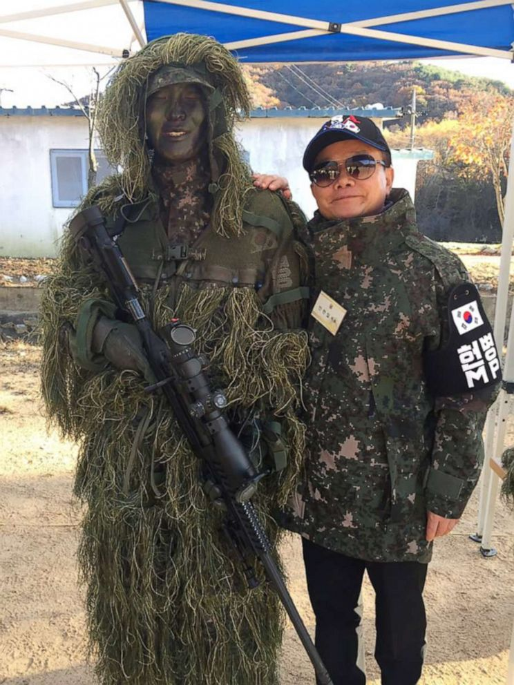 PHOTO: An Chan-il, 66, is a North Korea studies expert in Seoul who defected to South Korea through the demilitarized zone in 1979. He took a photo with a South Korean army soldier during a field trip to the border security area in Cherwon, South Korea.