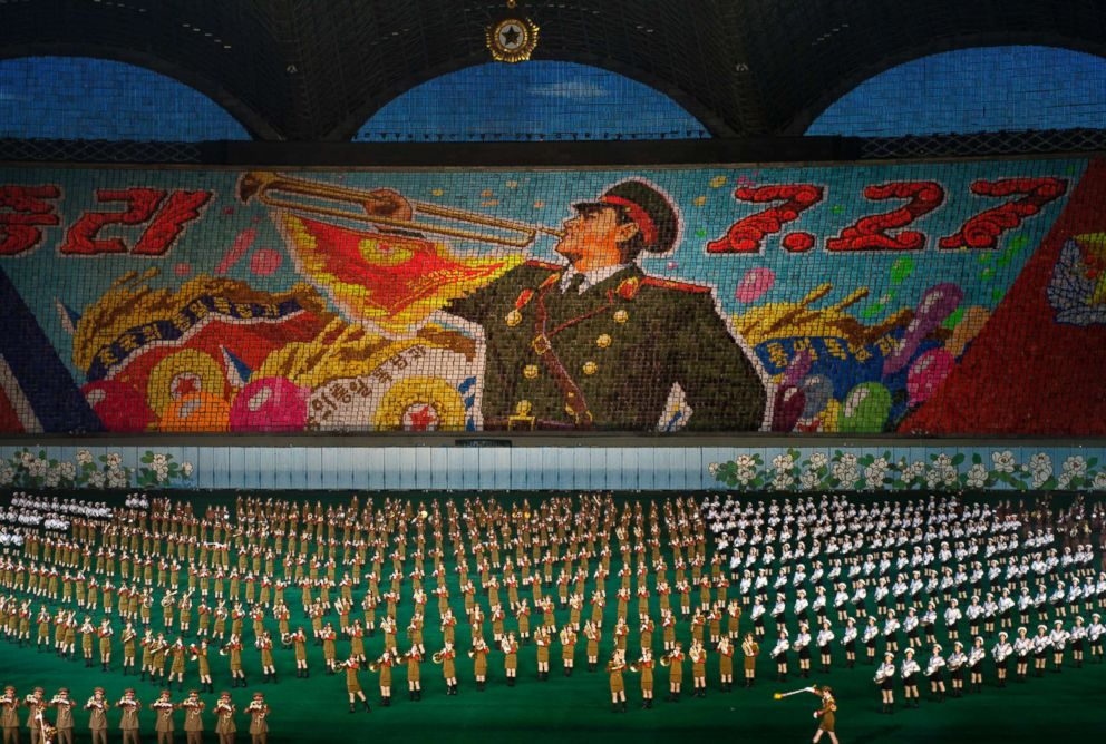 PHOTO: Performers create a giant picture in the stands as other march in formation during the Arirang Mass Games in Pyongyang, North Korea, Sept. 18, 2013.