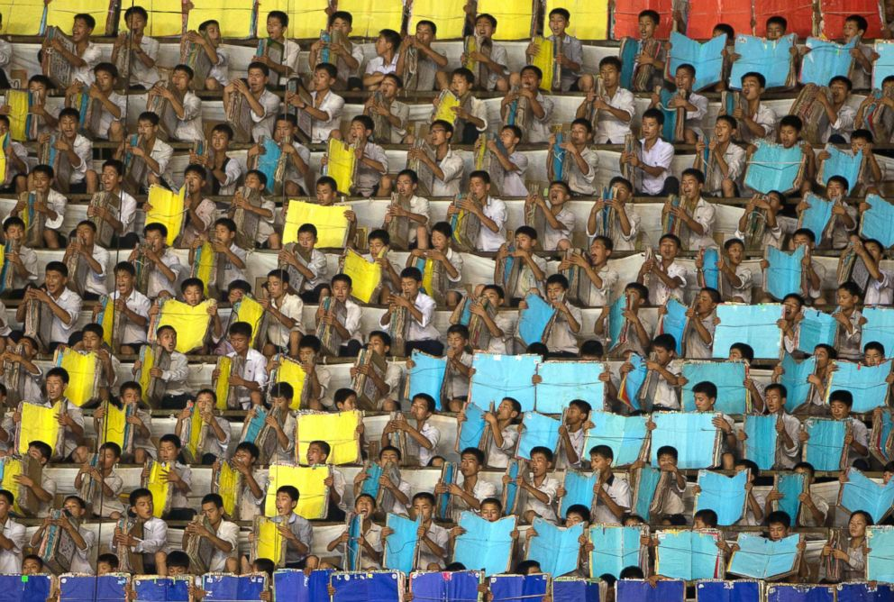 PHOTO: Performers warm up prior to the Arirang Mass Games at the 150,000-seat Rungnado May Day Stadium in in Pyongyang, North Korea, July 26, 2013.