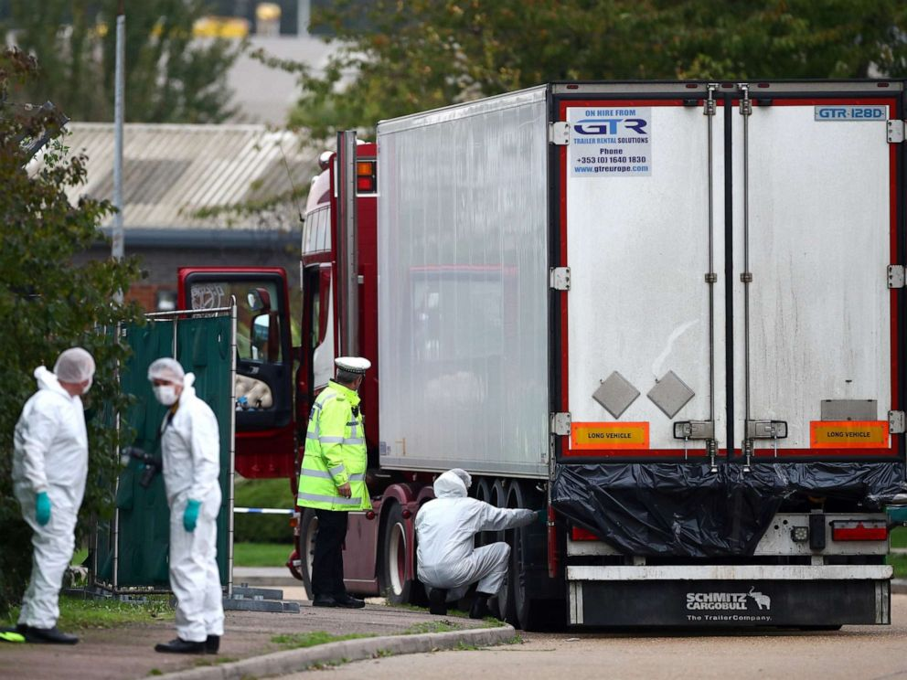 PHOTO: Police are seen at the scene where bodies were discovered in a lorry container, in Grays, Essex, Britain October 23, 2019. REUTERS/Hannah McKay