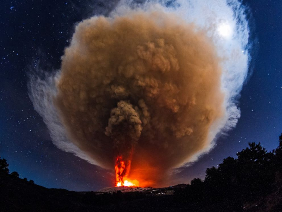 PHOTO: A massive volcanic plume emerges from Voragine crater as Mount Etna erupts in Sicily, Italy, Dec. 3, 2015.