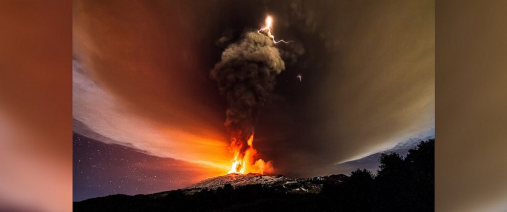 PHOTO: A dirty thunderstorm and volcanic lightning are seen above Mt. Etna in Sicily, Italy, Dec. 3, 2015.