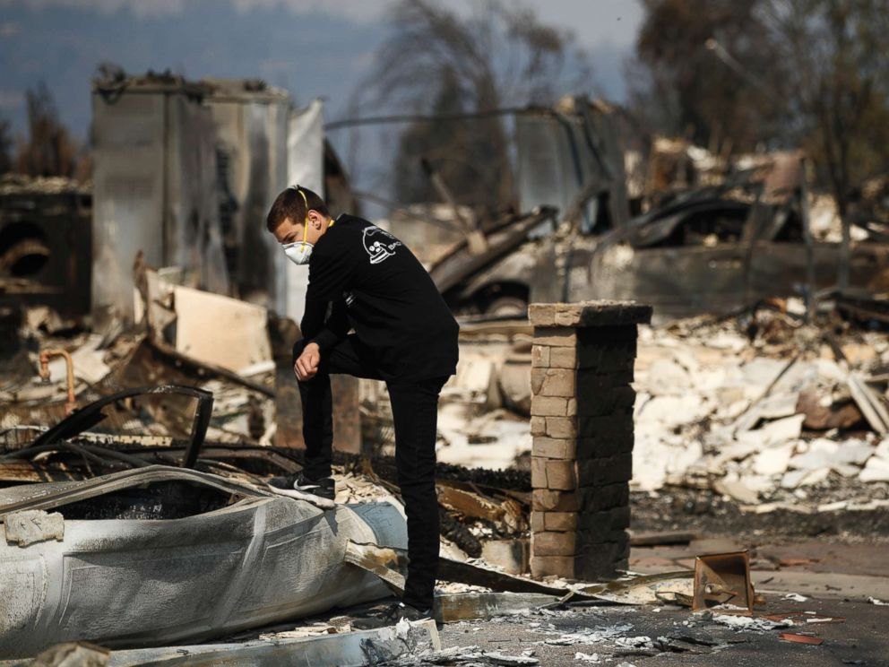 PHOTO: Benjamin Lasker, 16, looks at what remains of his home after a wildfire swept through on Oct. 15, 2017, in Santa Rosa, Calif.