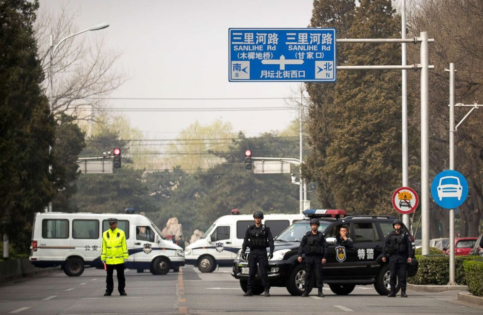 PHOTO: Police in tactical gear block a road leading to the Diaoyutai State Guesthouse in Beijing, Tuesday, March 27, 2018.